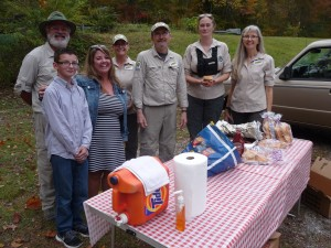 Wild South volunteers partake of donated food on Friday evening