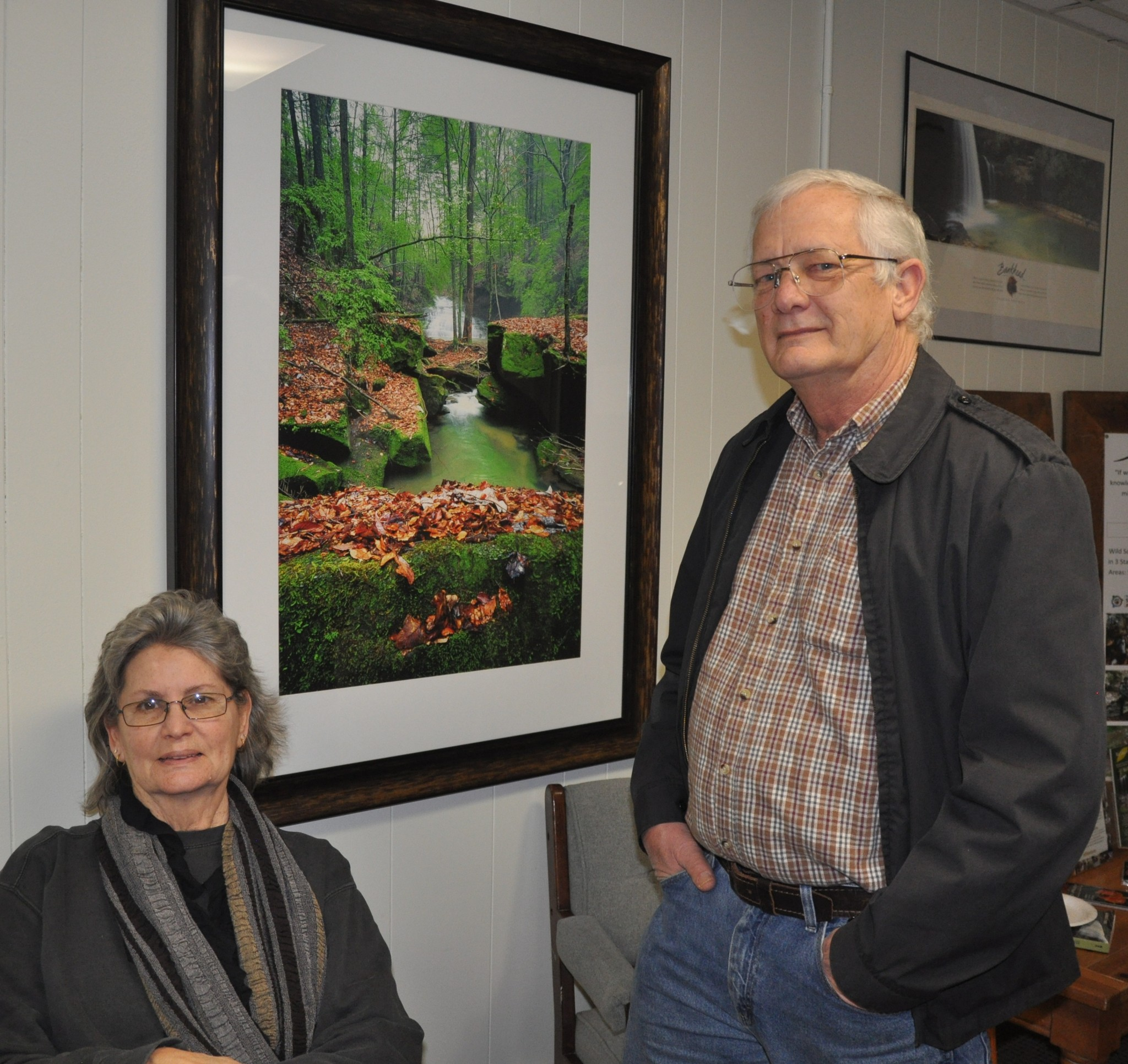 Barbara and Chuck Peterson with Charles Seifried's photograph of Eagle Creek Falls